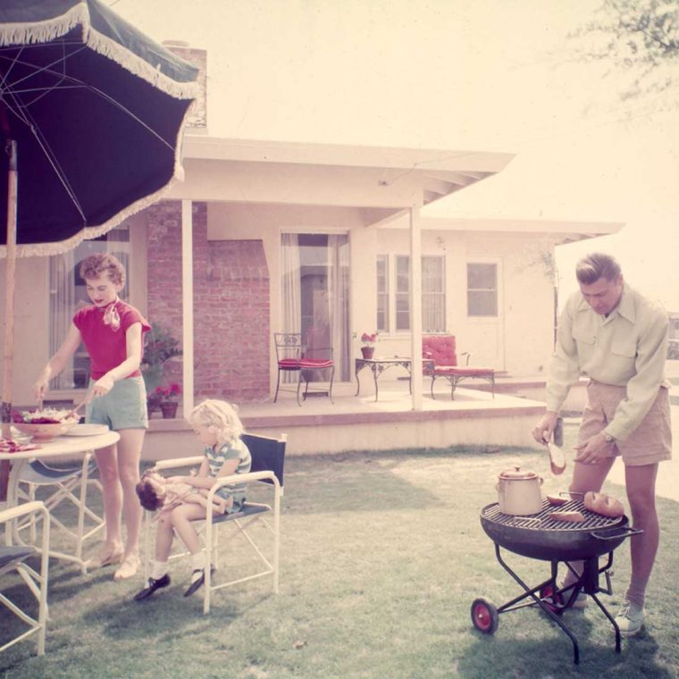 Family barbecue in Lakewood Plaza suburban development, Long Beach, California, ca. 1950. Architect: Chris Choate with designer Cliff May. Photo by Maynard L. Parker; The Huntington Library, San Marino, California.