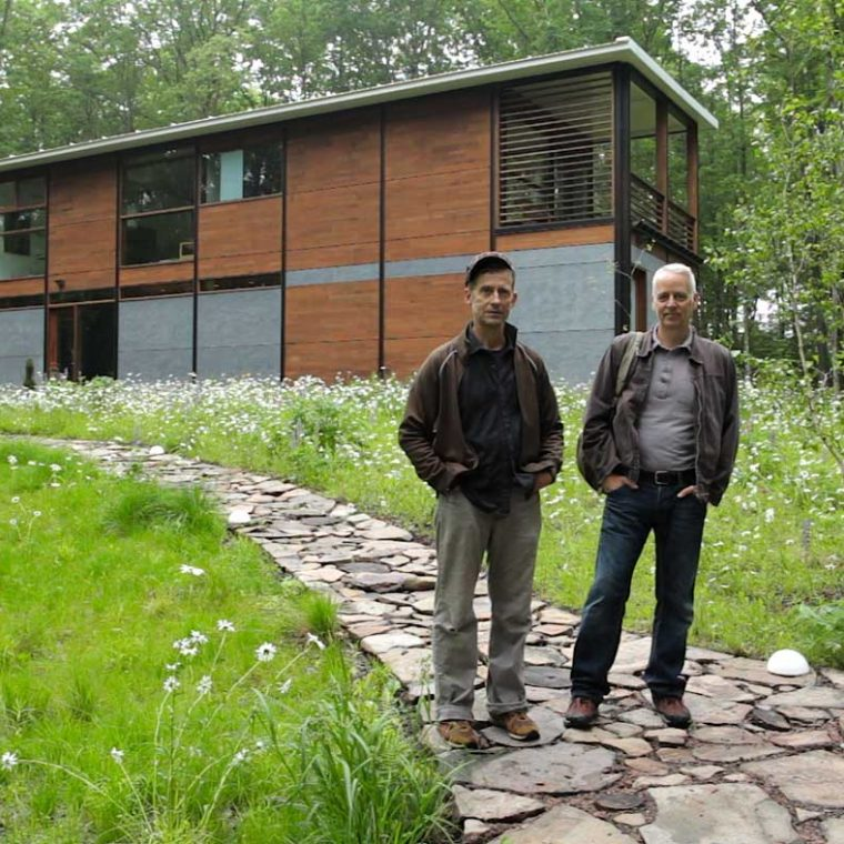 FlatPak House residents Rodney White and Thomas Brown, Callicoon, New York. Architect: Lazor Office. Built: 2008. Film Still: Ariel Efron; Local Projects.