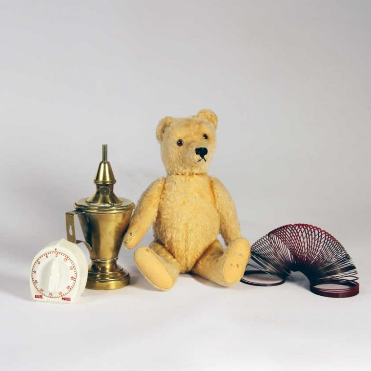 Kitchen timer, 1990s (Sally D. Liff); Whale oil lamp, c. 1810s; Teddy bear, 1930s (Cynthia Field); Slinky, 1960s. Photo by Museum staff.