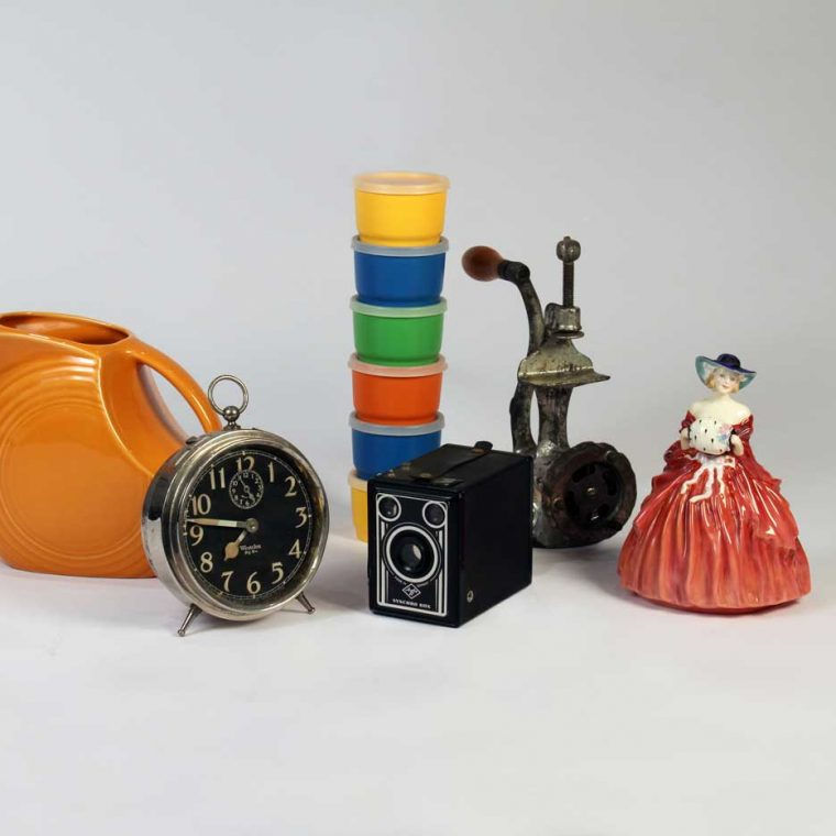 Fiestaware Pitcher, 1950s-60s; Big Ben alarm clock, 1920s; Tupperware snack cups, 1970s; Camera, 1940s (Howard County Historical Society, Ellicott City, Maryland); Meat grinder, 1940s; Royal Doulton figurine, 1962 (Private Collection). Photo by Museum staff.