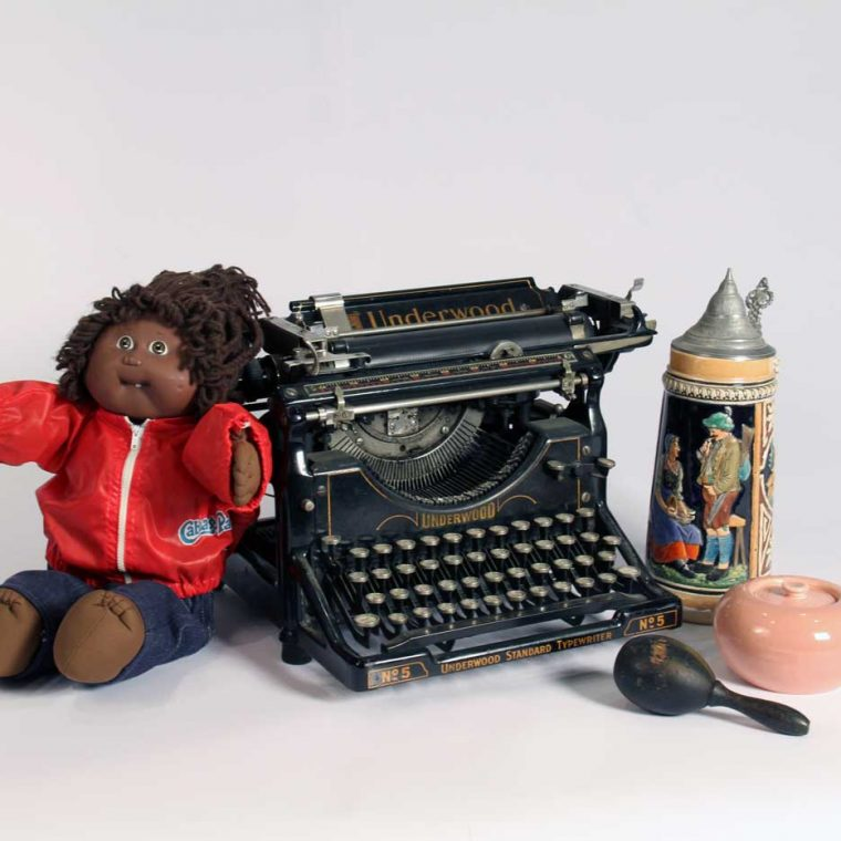 Cabbage Patch Doll, 1980s; Typewriter, early 20th century (Howard County Historical Society, Ellicott City, Maryland); Darning egg, c. 1920; Beer stein, 1940s (Hank and Karen Griffith); Russel Wright Sugar bowl, 1940s. Photo by Museum staff.