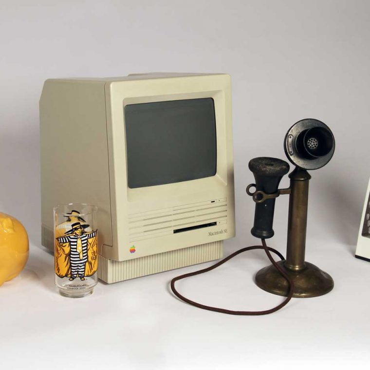 Toothbrush holder, 1970s; Hamburglar Juice Glass, 1980s; Macintosh computer monitor, 1987-1990; Candlestick telephone, 1920s; Cheese grater , 2007. Photo by Museum staff.