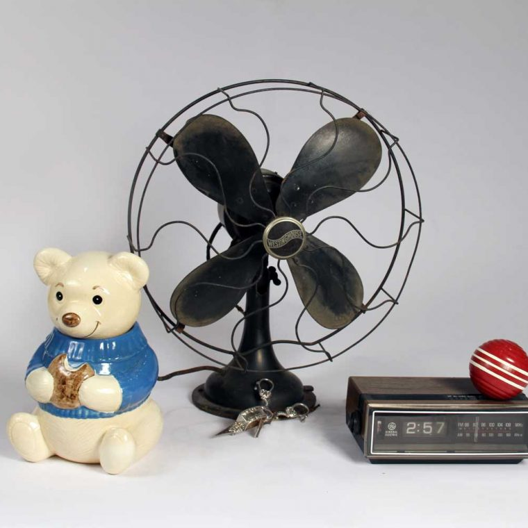Cookie jar, 1980s (C. W. Rynd); Table fan, 1920; Candle snuffer & wick trimmer, early 19th century (Howard County Historical Society, Ellicott City, Maryland); Clock radio, 1980s; Croquet ball, 1980s (Montgomery County Historical Society, Maryland). Photo by Museum staff.