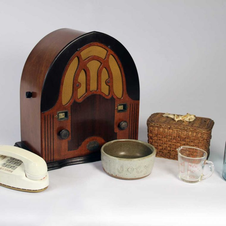 Princess telephone, 1959 (Marilyn and Michael Glosserman); Cathedral Radio, 1930s (National Capital Radio and Television Museum, Bowie, Maryland); Dog bowl for water, 1980s (Joanna Church); Sewing basket, mid 20th century (Howard County Historical Society, Ellicott City, Maryland); Pyrex liquid measuring cup, ca. 1950; Canning jar, 1940s (Curtis and Nancy Bateman). Photo by Museum staff.