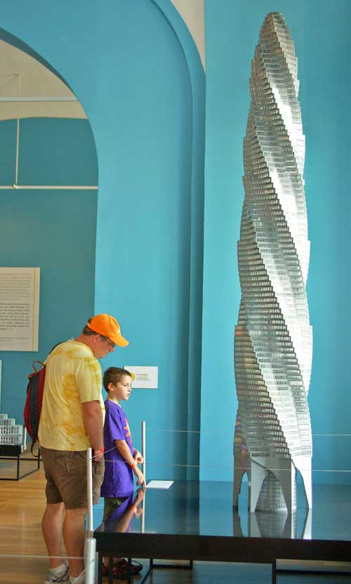Visitors to the National Building Museum's exhibition LEGO® Architecture: Towering Ambition look at Adam Reed Tucker's model of the unbuilt Chicago Spire designed by Santiago Calatrava.