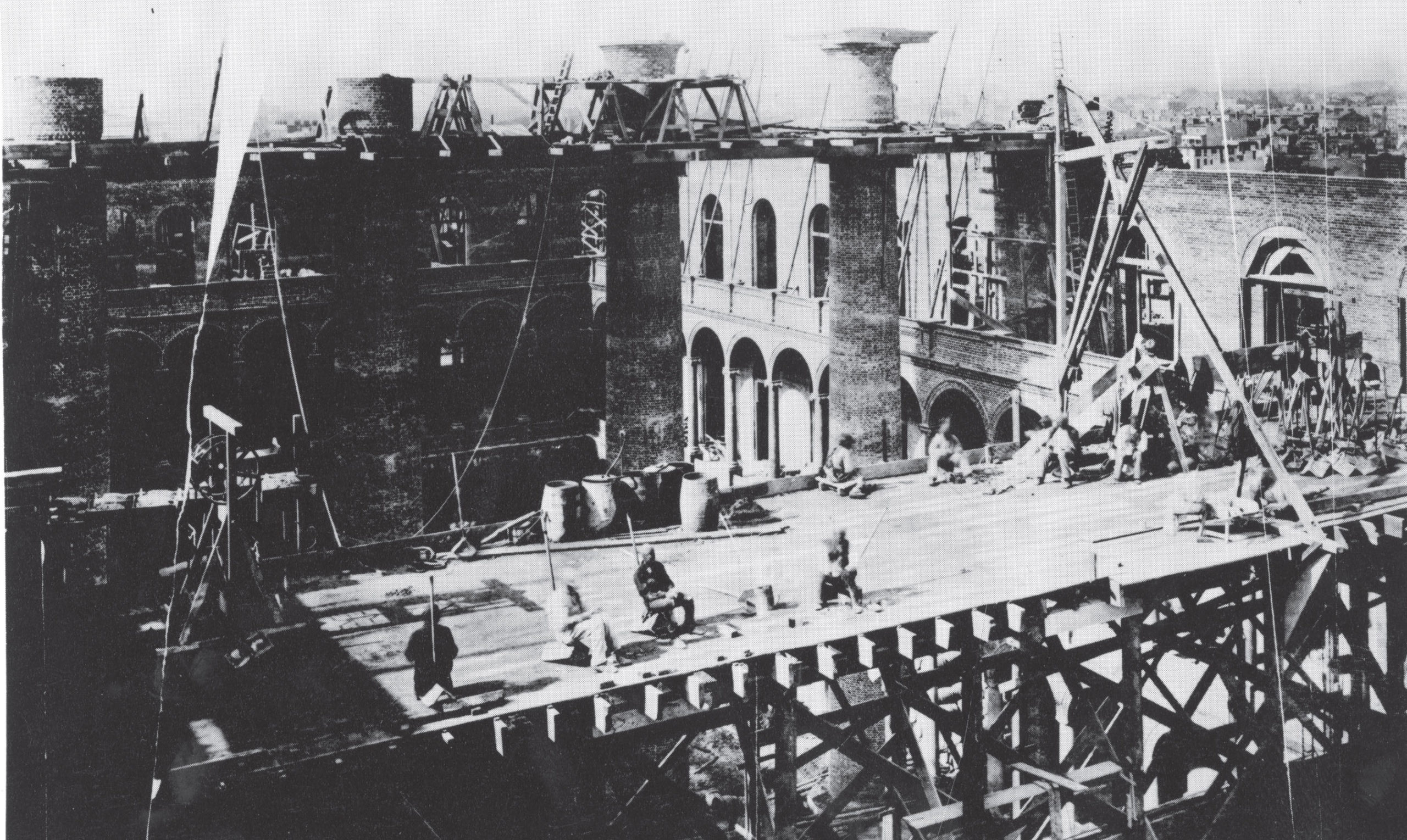 Historic photo of the construction of the Pension Building, 1880s.