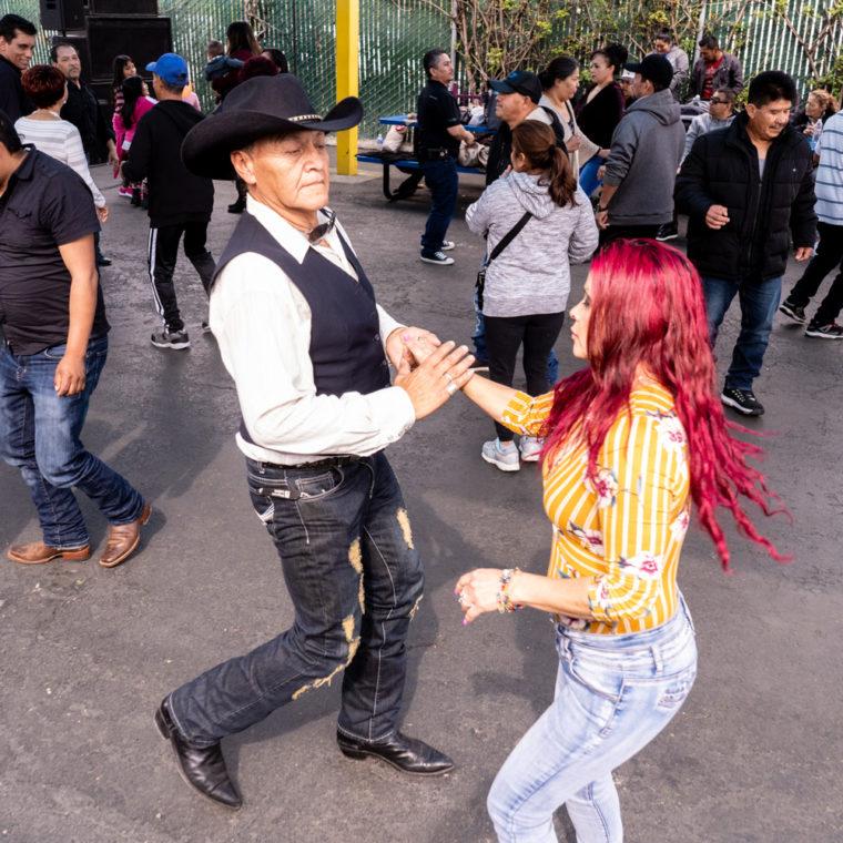 March 8, 2020: Dancing at the West Wind Coliseum Public Market, 5401 Coliseum Way, Oakland, California. © Camilo José Vergara