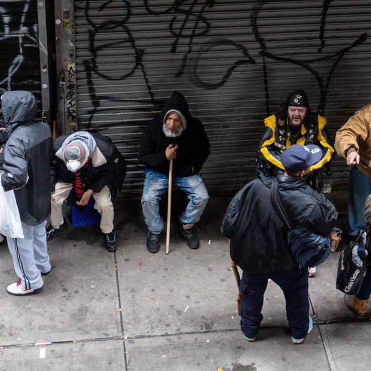 March 30, 2020: Socializing under the Myrtle Avenue Subway Station, 943 Broadway, Brooklyn, New York. © Camilo José Vergara