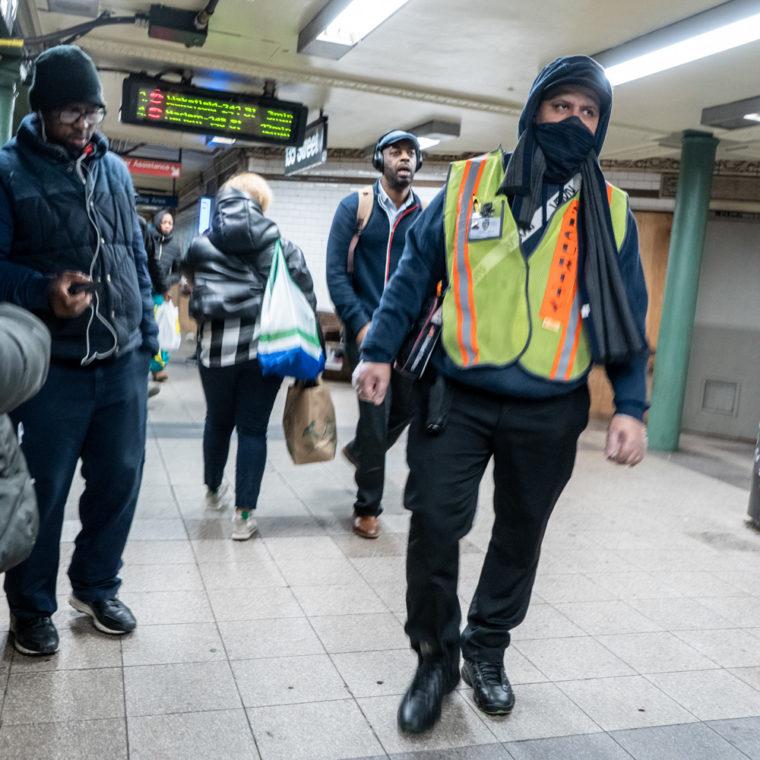 March 18, 2020: Security guard at 135th Street subway station at Lenox Avenue, Harlem, New York, New York. © Camilo José Vergara