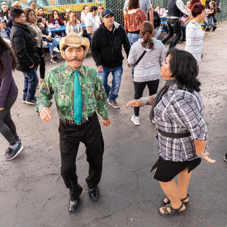 March 8, 2020: Ermelinda dancing at the West Wind Coliseum Public Market, 5401 Coliseum Way, Oakland, California. © Camilo José Vergara