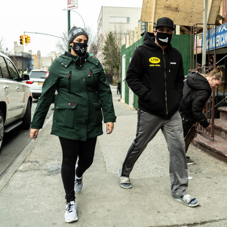 March 18, 2020: Couple wearing his and hers masks, Willis Avenue at 143rd Street, Bronx, New York. © Camilo José Vergara