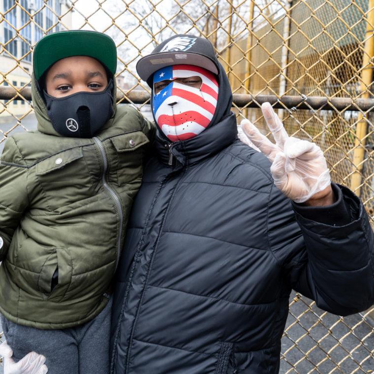 March 29, 2020: Jamal and his son Jamal Jr. on Willis Avenue at East 140th Street, Bronx, New York. © Camilo José Vergara