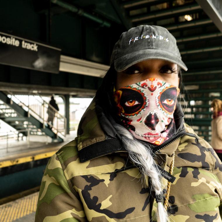 March 30, 2020: Tasha wearing her custom-crafted mask at the Broadway Junction subway station, Brooklyn, New York. © Camilo José Vergara