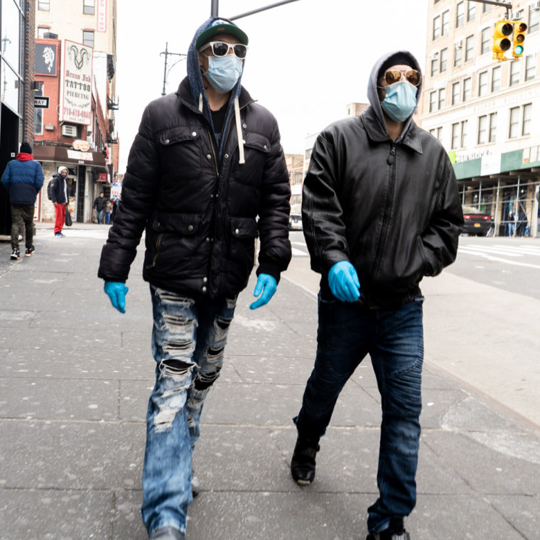 March 31, 2020: Friends wearing their version of protective gear on East 149th Street west of Third Avenue, Bronx, New York. © Camilo José Vergara