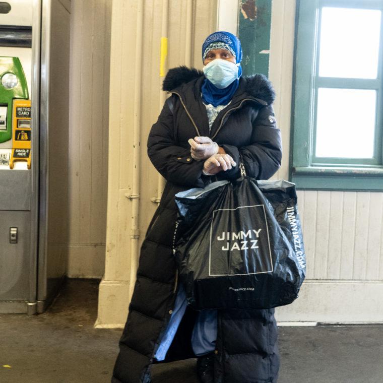 March 19, 2020: Healthcare worker waiting for the train, Simpson Avenue subway station, Bronx, New York. © Camilo José Vergara