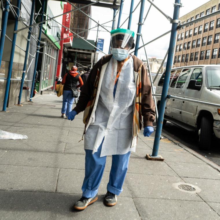 March 31, 2020: Healthcare worker on East 149th Street near Third Avenue, Bronx, New York. © Camilo José Vergara