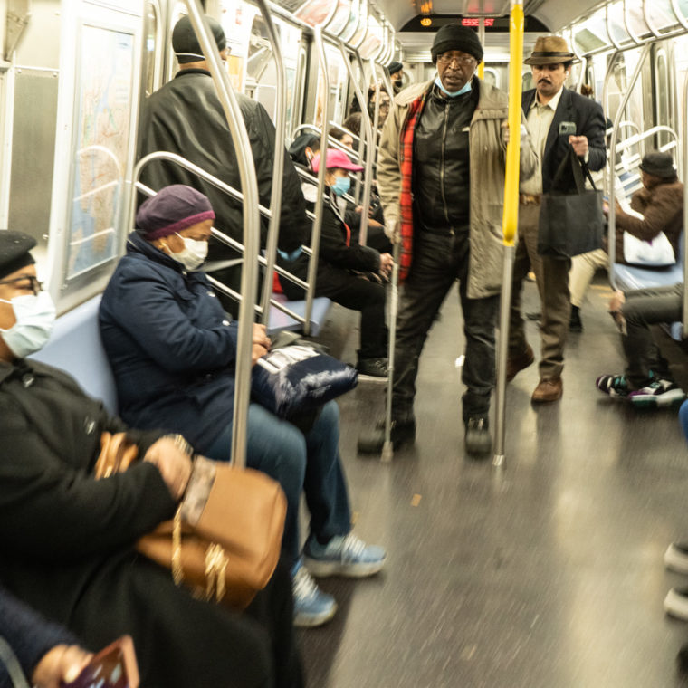 March 30, 2020: Riding the J train at Essex Street subway station, New York, New York. © Camilo José Vergara