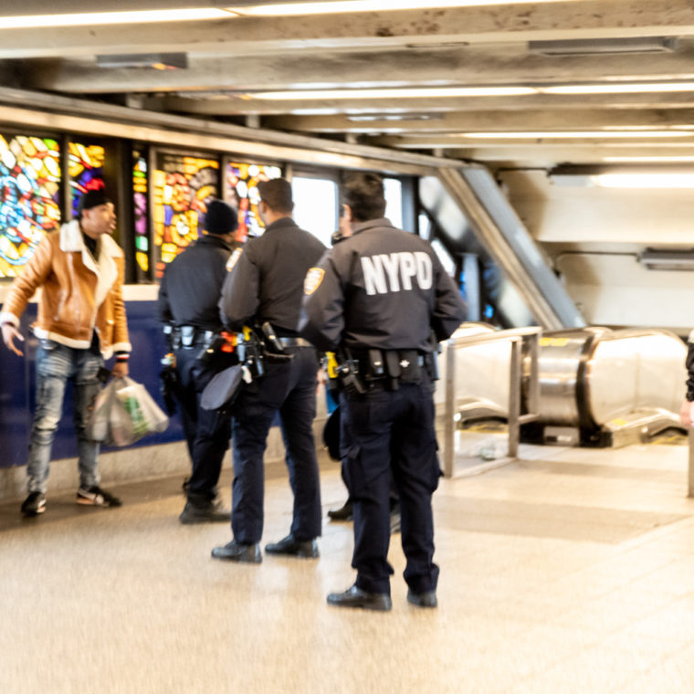 March 25, 2020: Disruptive man surrounded by police officers at Broadway Junction subway station, Brooklyn, New York. © Camilo José Vergara