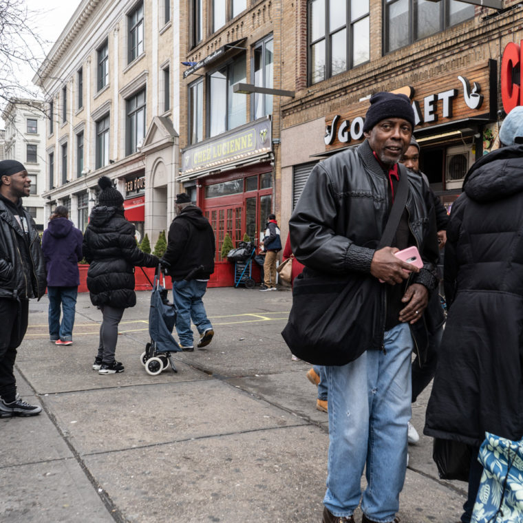 April 4, 2020: Waiting in line outside CFSC Checks Cashed, 302 Malcolm X Boulevard, Harlem, New York, New York. © Camilo José Vergara