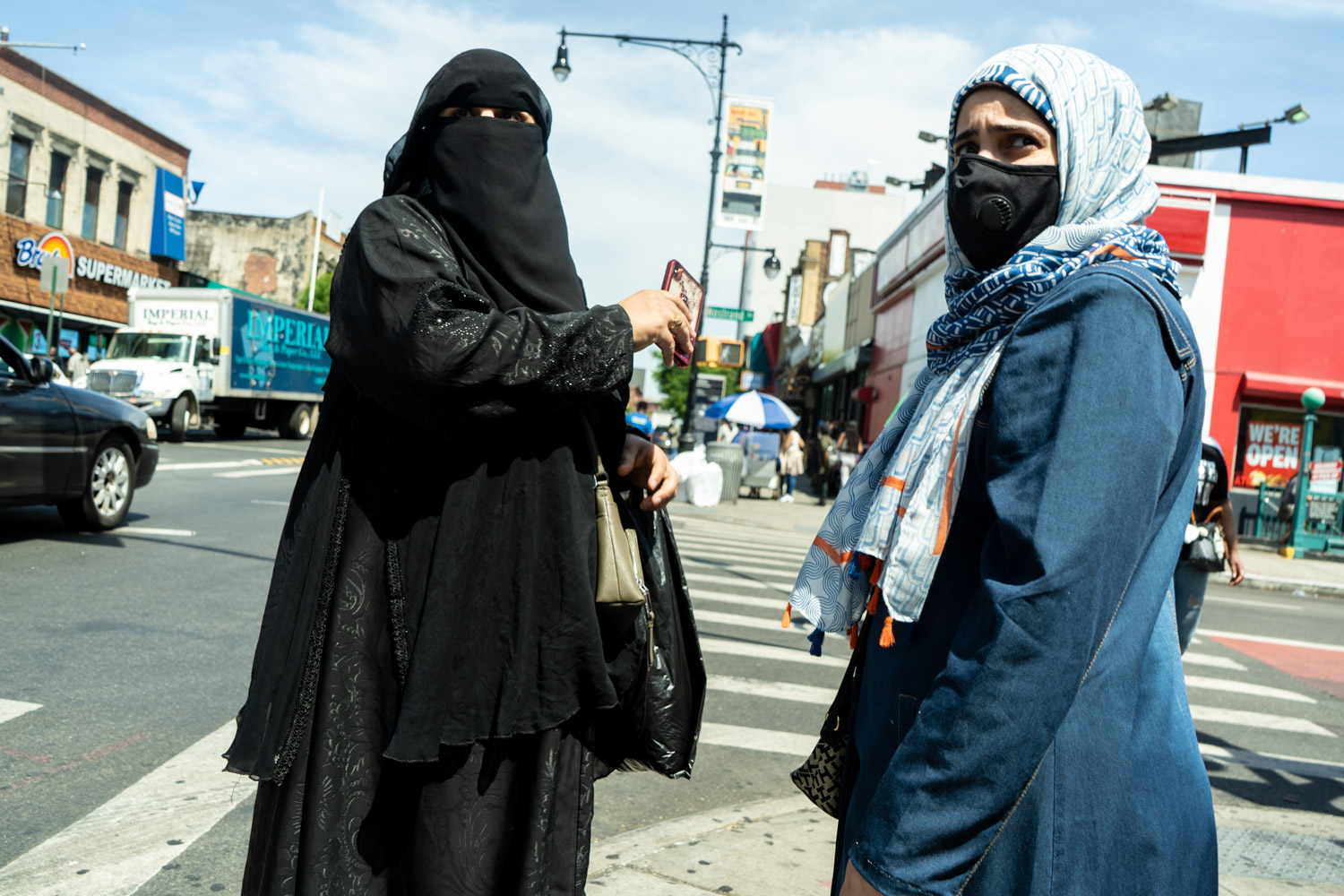 June 16, 2020: Two women on Fulton Street at Nostrand Avenue, Brooklyn, NY. © Camilo José Vergara