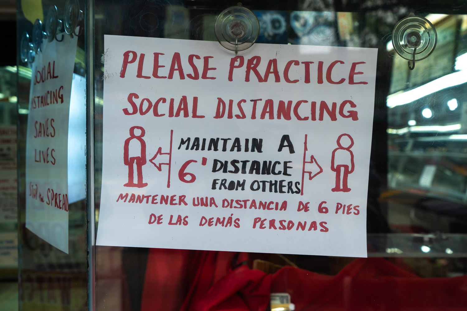 May 2, 2020: Hand-drawn sign posted at a pawn shop on Southern Boulevard near Aldus Street, Bronx, NY. © Camilo José Vergara
