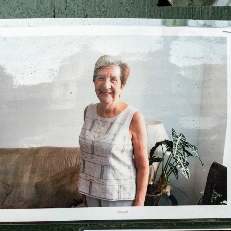 """August 9, 2020: Ifigenia Cardenas, victim of the pandemic. A passerby told me that the lady in this photo used to buy groceries at the supermarket where he once worked. """"Memorial to Those Who Walked With Us,"""" by Make the Road New York, depicting young and old residents of Corona killed by Covid-19. 104-21 Roosevelt Avenue, Queens, New York. © Camilo José Vergara"""