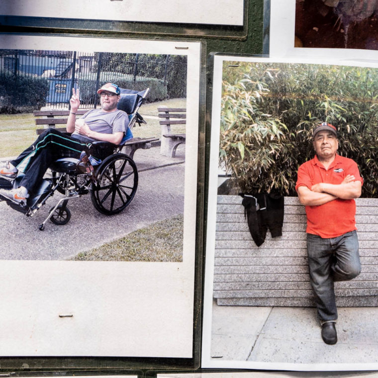 """August 30, 2020: Pietro Fabrizio Idrovo Vasa (left) and Santiago Castro (right), victims of the pandemic. """"Memorial to Those Who Walked With Us,"""" by Make the Road New York, depicting young and old residents of Corona killed by Covid-19. 104-21 Roosevelt Avenue, Queens, New York. © Camilo José Vergara"""
