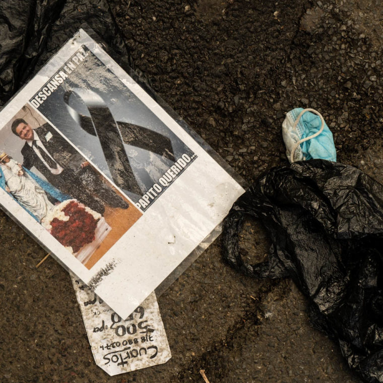 """October 4, 2020: Discarded portrait of a victim of the pandemic. It was part of """"Memorial to Those Who Walked With Us,"""" by Make the Road New York, depicting young and old residents of Corona killed by Covid-19. 104-21 Roosevelt Avenue, Queens, New York. © Camilo José Vergara"""