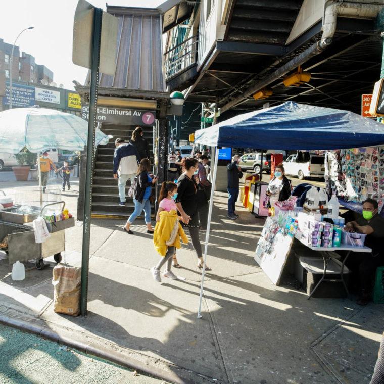 November 7, 2020: Street vendors at the entrance to the 7 Train. Elmhurst Avenue at 90th Street, Queens, New York. © Camilo José Vergara
