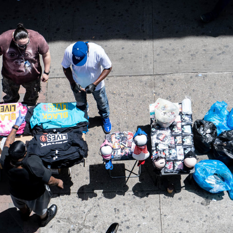June 17, 2020: Black Lives Matter T-shirts and PPE for sale under the Simpson Street Subway Station. Westchester Avenue south of Southern Boulevard, Bronx, New York. © Camilo José Vergara