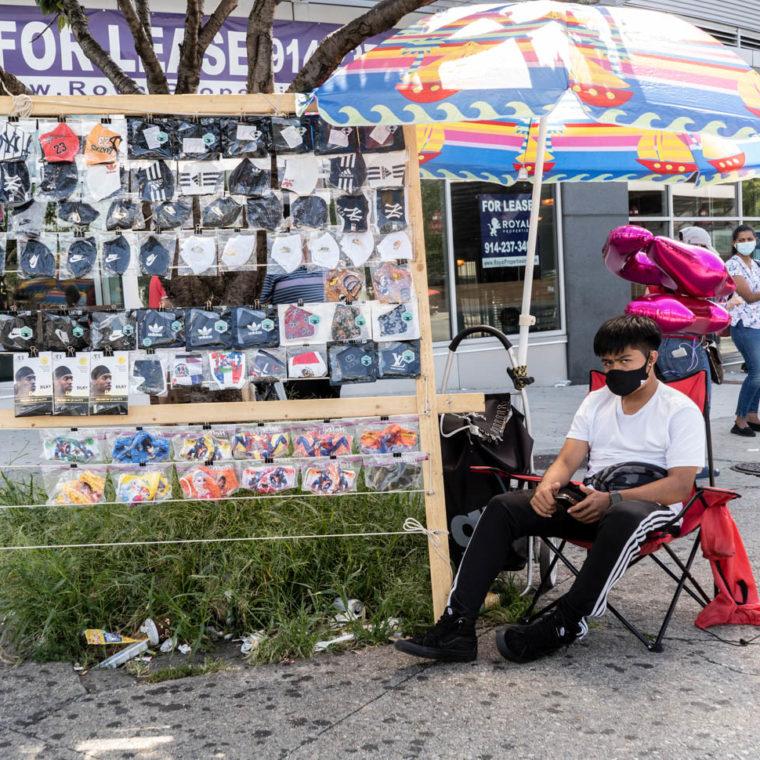 August 17, 2020: Teenager selling masks. 928 Hunts Point Avenue, Bronx, New York. © Camilo José Vergara