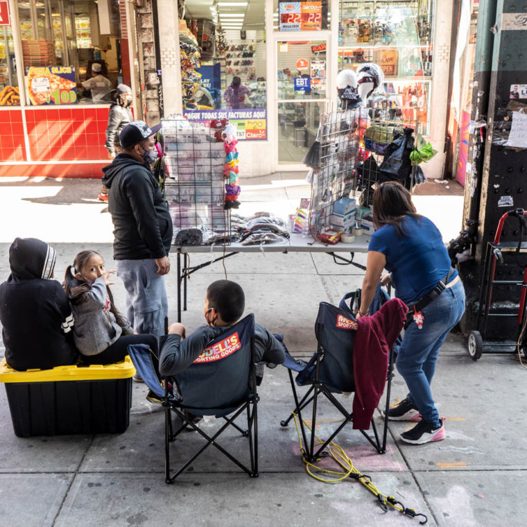 September 21, 2020: Street vendors and their children selling PPE and articles of clothing. 2278 Jerome Avenue, Bronx, New York. © Camilo José Vergara
