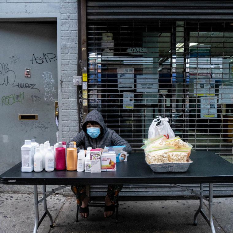 November 15, 2020: Child street vendor. 9215 Roosevelt Avenue, Queens, New York. © Camilo José Vergara