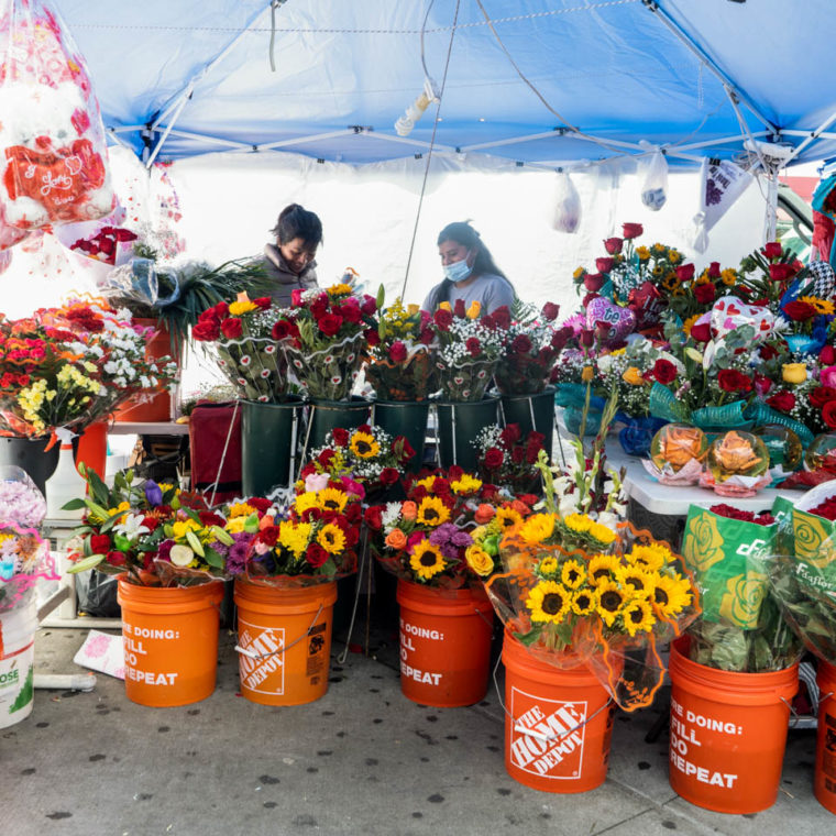 September 20, 2020: Selling flowers, dresses, and balloons. National Street at Roosevelt Avenue, Queens, New York. © Camilo José Vergara