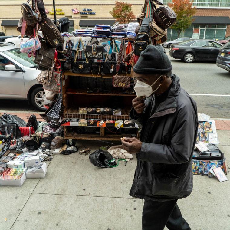 October 23, 2020: Selling knockoff Gucci and Fendi. 855 Broad Street, Newark, New Jersey. © Camilo José Vergara
