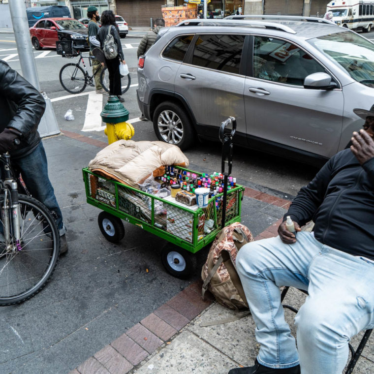 """October 23, 2020: The $100 cart from Home Depot is """"movable,"""" the oil and African soap vendor in the picture told me. Market Street at Halsey Street, Newark, New Jersey. © Camilo José Vergara"""