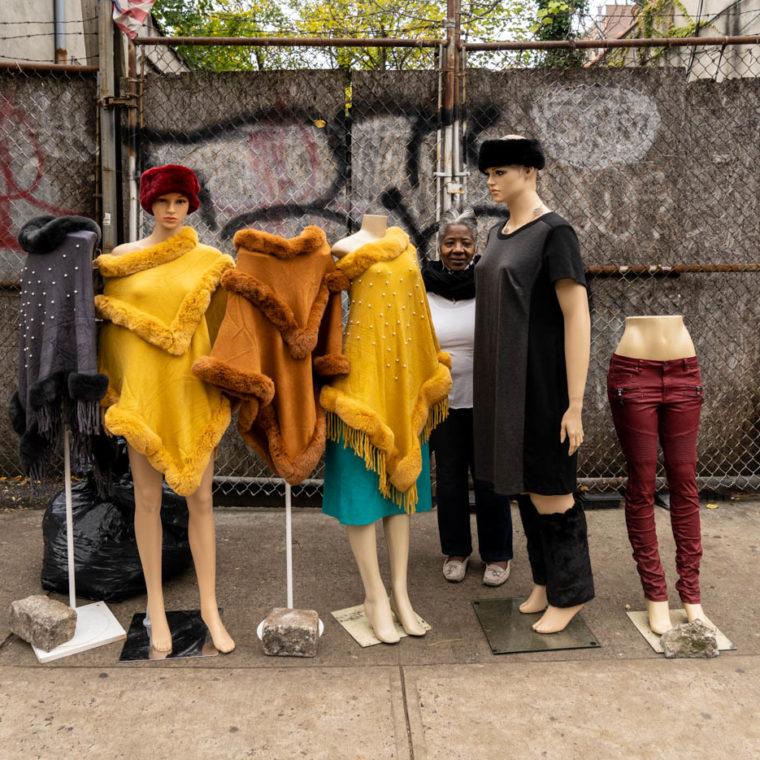 """November 22, 2020: """"O,"""" originally from Jamaica, selling clothes at 642 Nostrand Avenue, Brooklyn, New York. © Camilo José Vergara"""
