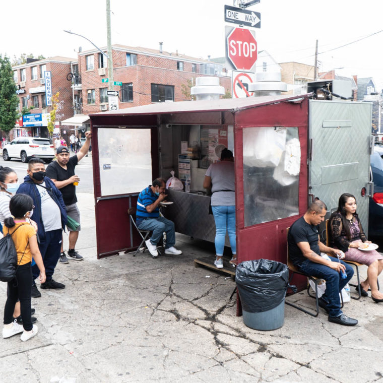 September 27, 2020: Food truck with sitting area. Roosevelt Avenue at 99th Street, Queens, New York. © Camilo José Vergara