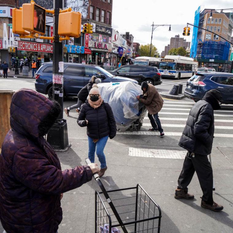November 2, 2020: Street vendors setting up shop. East 149th Street at Third Avenue, Bronx, New York. © Camilo José Vergara