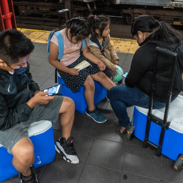 October 20, 2020: The end of the day for a food-vending family. 96th Street Station at Broadway, New York, New York. © Camilo José Vergara