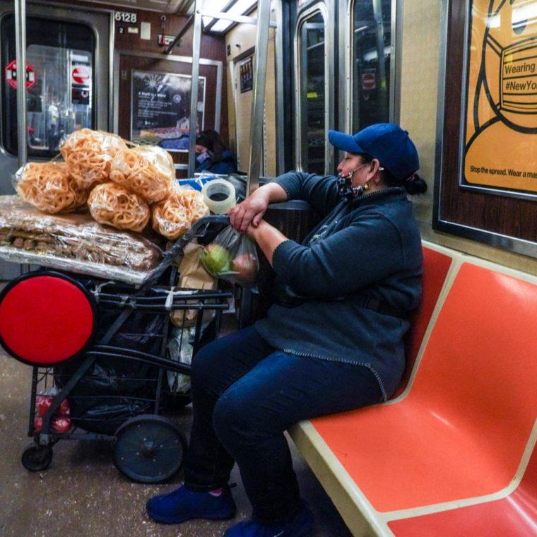 November 4, 2020: Food vendor on the A train. New York, New York. © Camilo José Vergara