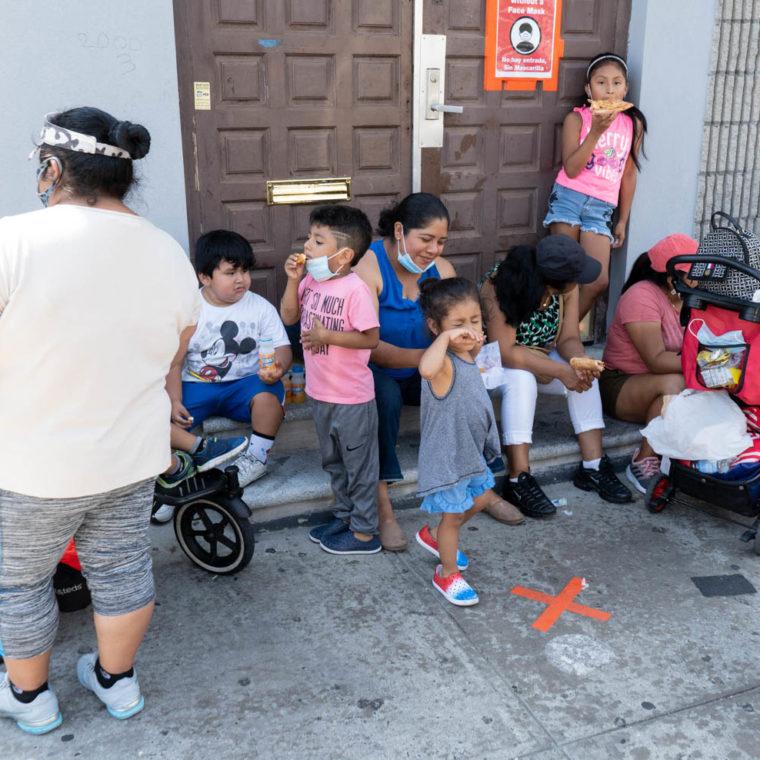 August 17, 2020: Families waiting for free food. Corona Seventh Day Adventist Church, 3530 103rd Street, Queens, New York. © Camilo José Vergara