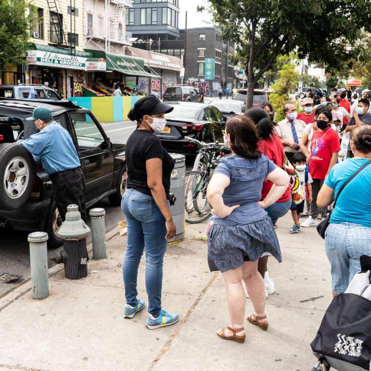 September 9, 2020: Free food being given away at Knickerbocker Avenue in front of Maria Hernandez Park, Brooklyn, New York. © Camilo José Vergara