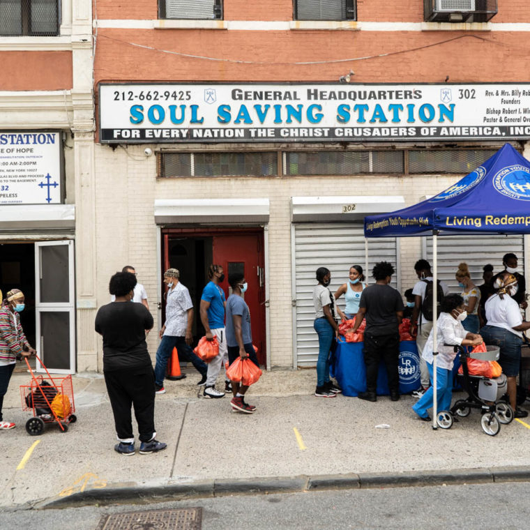 August 28, 2020: Soul Saving Station Headquarters. The organization gives away free food to people that come or sends volunteers with free food to people unable to come and pick it up. 302 West 124th Street, Harlem, New York, New York. © Camilo José Vergara