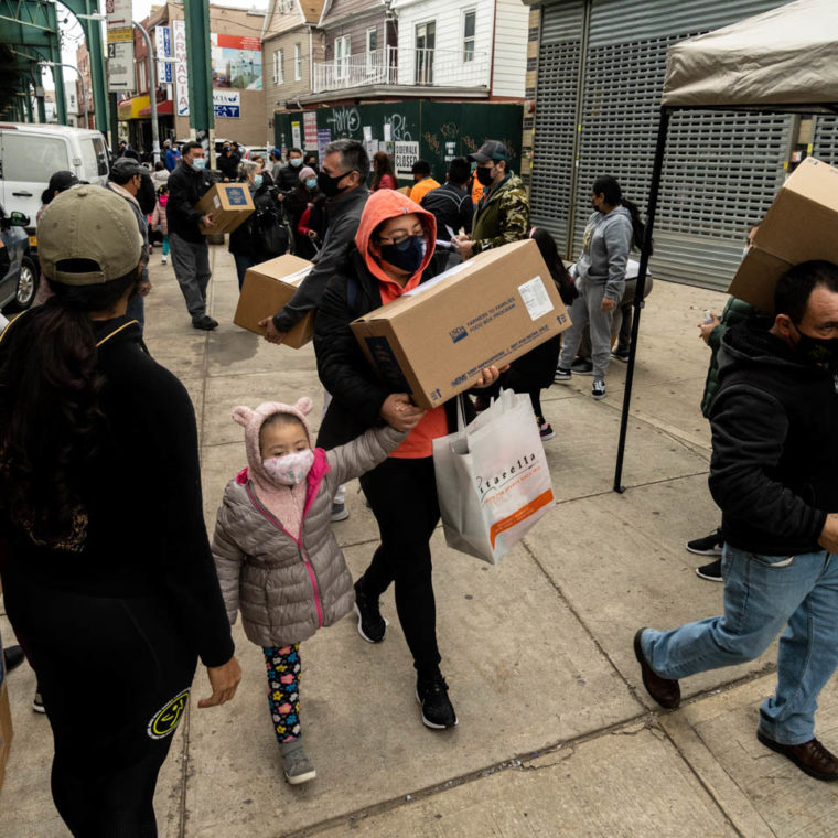 November 28, 2020: Boxes of food donated by the U. S. Department of Agriculture being distributed by the Centro Comunitario Andino. 104-10 Roosevelt Avenue, Queens, New York. © Camilo José Vergara