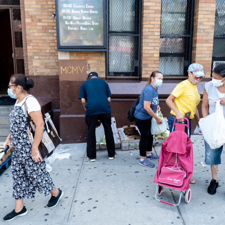 September 3, 2020: People helping themselves to left over cauliflower, broccoli, and cabbage. Creston Avenue Baptist Church, 114 East 188th Street, Bronx, New York. © Camilo José Vergara