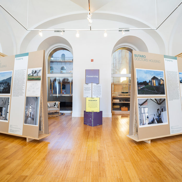 The exhibition is organized by five themes that represent MASS Design Group's approach to design and body of work: Engaging, Healing, Fostering, Conserving, and Marking.